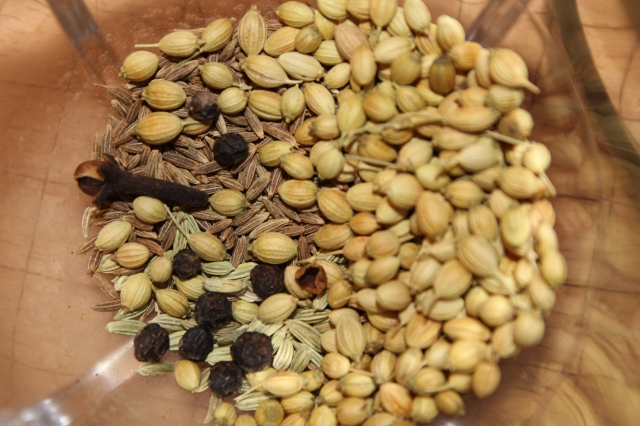 Whole spices: peppercorns, cloves, fennel, cumin and coriander seeds