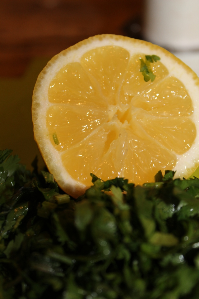 Half a lemon and chopped cilantro for garnishing