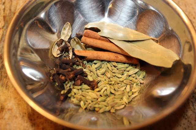Clockwise: Bay leaves, cinnamon sticks, fennel, cloves and cardamom