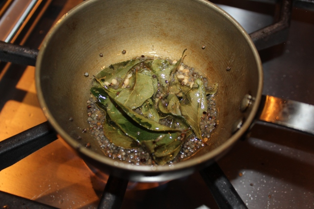 Tempering mix of mustard, black Bengal gram dal and curry leaves
