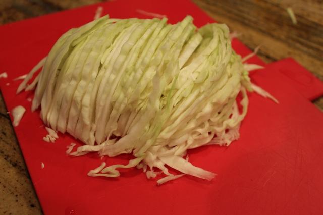 Slice cabbage lengthwise