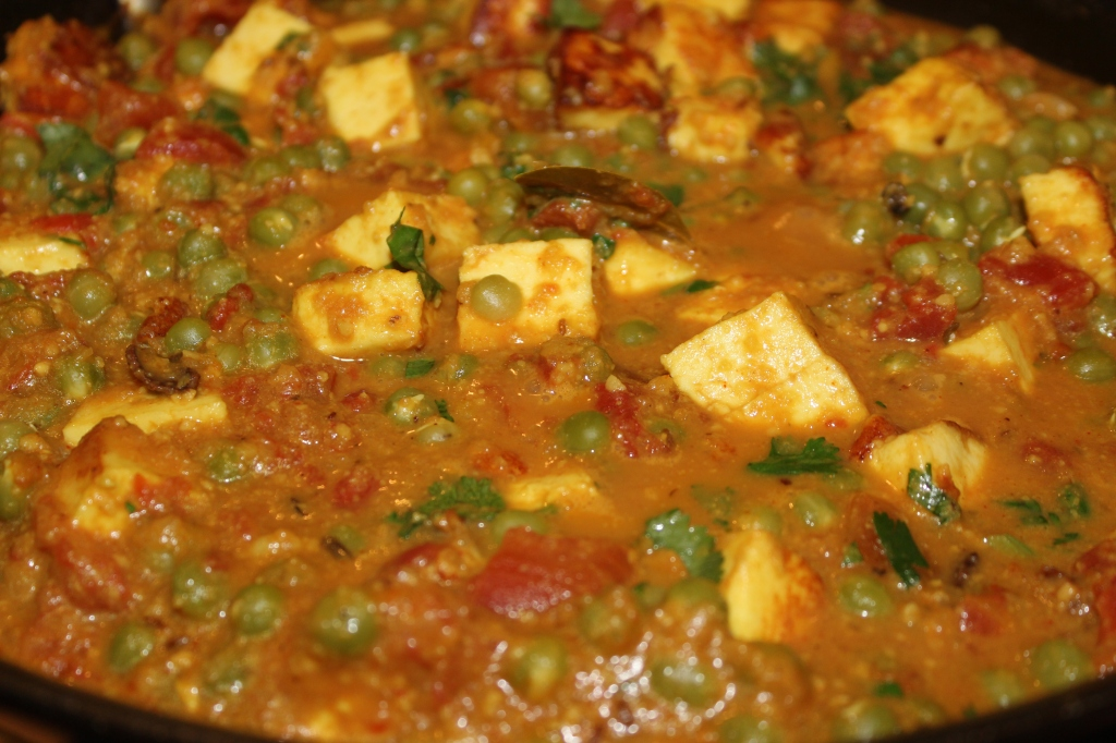 Fold in the peas and paneer