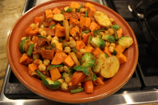 Toss the sauce with the cubed vegetables and mound into the tagine base