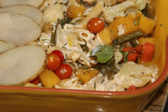 A medley of vegetables tossed with penne in a creamy sauce.
