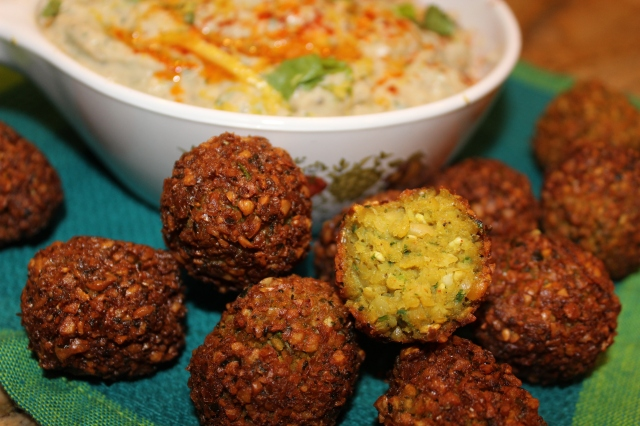 Falafels, tinted with a hint of turmeric and flecked with green parsley